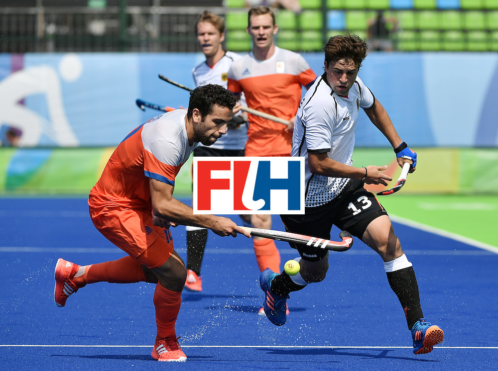Netherlands' Valentin Verga (L) vies with Germany's Tobias Hauke during the men's Bronze medal field hockey Netherlands vs Germany match of the Rio 2016 Olympics Games at the Olympic Hockey Centre in Rio de Janeiro on August 18, 2016. / AFP / Pascal GUYOT        (Photo credit should read PASCAL GUYOT/AFP/Getty Images)