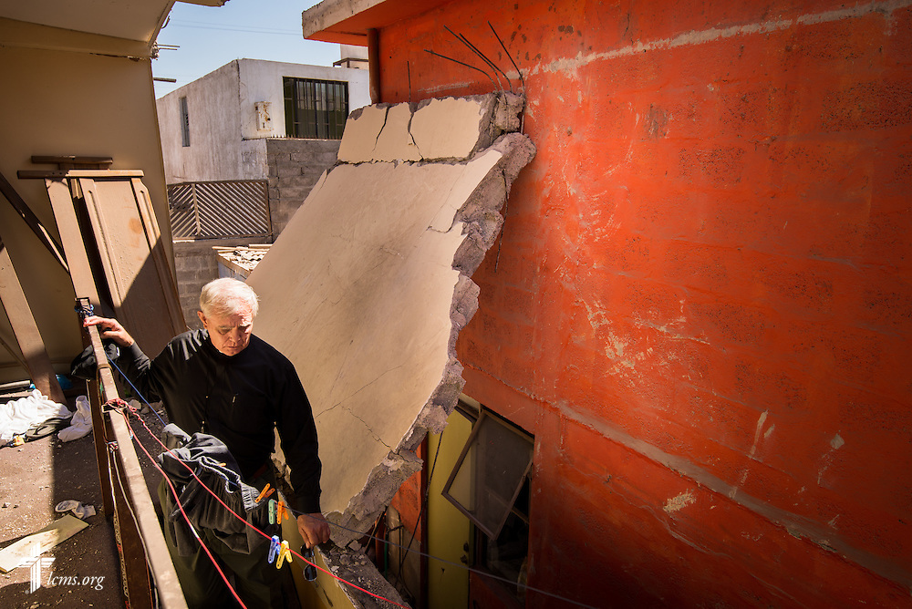 The Rev. Glenn Merritt, outgoing director of LCMS Disaster Response, walks down a stairwell in a severely damaged home on Wednesday, April 23, 2014, in Alto Hospicio, Chile. The home was damaged from a magnitude 8.2 earthquake on April 1, 2014, that struck approximately 95km northwest of Iquique. The earthquake condemned several thousand homes and severely damaged more than 10,000 others. LCMS Communications/Erik M. Lunsford