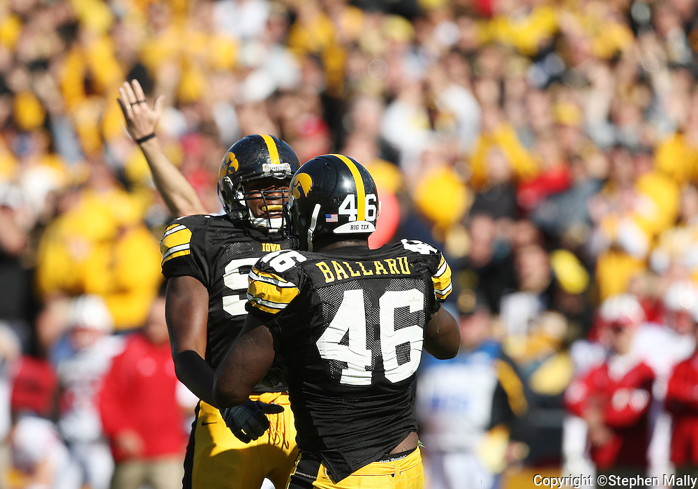 18 OCTOBER 2008: Iowa defensive end Broderick Binns (91) congratulates Iowa defensive end Christian Ballard (46) on his sack in the second half of an NCAA college football game against Wisconsin, at Kinnick Stadium in Iowa City, Iowa on Saturday Oct. 18, 2008. Iowa won 38-16.