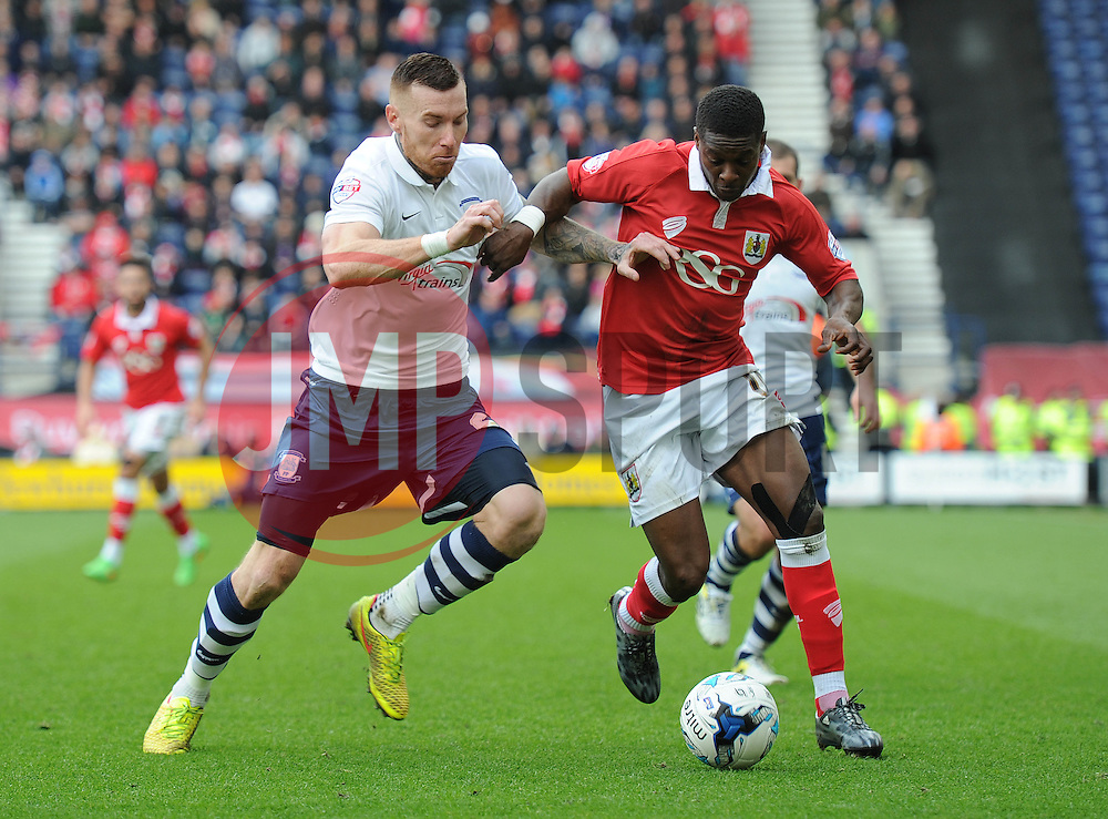 Bristol City's Kieran Agard is challenged by Preston North End's Jack King - Photo mandatory by-line: Dougie Allward/JMP - Mobile: 07966 386802 - 11/04/2015 - SPORT - Football - Preston - Deepdale - Preston North End v Bristol City - Sky Bet League One