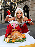 Repro Free: 04/12/2012.Dustin took to the streets in protest today as Betfair prepares to give away 150 Irish turkeys in their annual 'Beat the Budget' giveaway. Model Tiffany Stanley was on hand to ensure that everyone's fowl friend doesn't scupper the company's plan to give the birds away from a braded butchers shop on Lower Camden Street tomorrow. Dustin has vowed to step up his protestations and will be taking the fight to Camden Street tomorrow. Pic Andres Poveda.