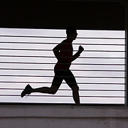 A photo of a silhouetteof a man running in a parking garage in Reno in Nevada