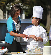 First lady Michelle Obama and White House Chef Christeta Pasia Comerford hosts a healthy Kids Fair on the South Lawn of the White House to promote healthy activities and food. photograph: Dennis Brack