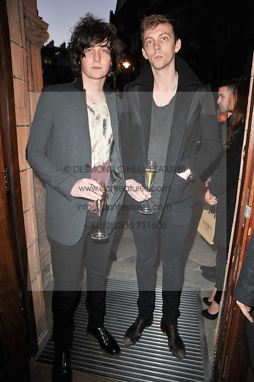 Left to right, GEORGE CRAIG former boyfriend of Emma Watson and his brother JAMES CRAIG at the opening of Loewe's new boutique at 125 Mount Street, London on 23rd March 2011.