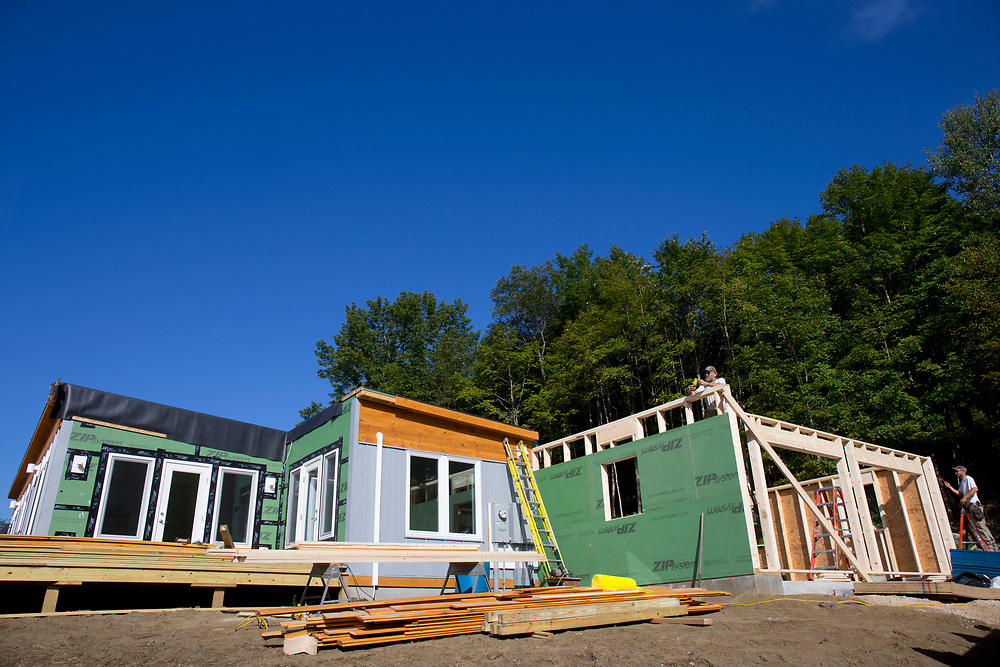 Doc Conniff, left, and his son, Rob, work to build a garage onto a 1,500 square-foot net zero modular home in Woodstock, Vt., on Aug. 30, 2017. The Conniffs have been working with Vermod Homes owner Steve Davis on building projects for 30 years. (Photo by Geoff Hansen)
