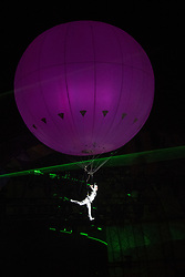 © Licensed to London News Pictures. 04/08/2017 Wilderness Festival Saturday night Spectacle this year a laser and music show that featured a heliosphere and acrobat that floated above the crowd.. Photo credit : MARK HEMSWORTH/LNP