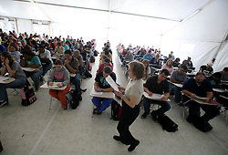 30 Jan, 2006. New Orleans, Louisiana.  Post Katrina.<br /> Five months after hurricane Katrina hit the city, the University of New Orleans welcomes some 12,000 students back to their Lakefront campus. Students listen in to Lecturer Dr Phyllis Raabe and her Introductory Sociology to students in a temporary tent as the facility looks to upgrade all its facilities.<br /> Photo; Charlie Varley/varleypix.com