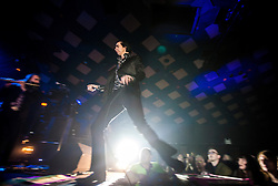 A wide angle shot of the frontman Nick Cave passing back onto the stage, Nick Cave and the Bad Seeds, on stage tonight at The Barrowlands, Glasgow, Scotland.<br /> &copy;Michael Schofield.