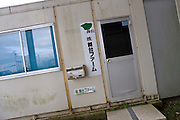 Signs of recovery in Miyagi Prefecture, Japan on 01 Dec., 2011. .Photographer: Robert GilhoolyPhoto shows entrance to Butai Farm's offices and facilities in Sendai, Japan on December 01, 2011.  The company was established as Butai Farm in 2003 with the idea of developing a company that would work on the whole farming process -- from production to processing, distribution, and sales. The March 11 tsunami flooded about 60% of the company's 40-hectare farmland. While working toward the reconstruction of the land, they have also introduced a three-tier radiation testing system in an attempt to recover consumer confidence..Photographer: Robert Gilhooly