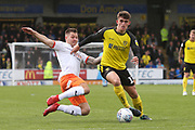 Burton Albion midfielder Ben Fox (12) and Luton Town forward James Collins (19) during the EFL Sky Bet League 1 match between Burton Albion and Luton Town at the Pirelli Stadium, Burton upon Trent, England on 27 April 2019.