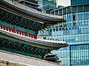 """08 JUNE 2018 - SEOUL, SOUTH KOREA:  Namdaemun, the """"Great South Gate,"""" which was the main southern gate to the old city with Seoul's modern skyline around it. The gate is next to Namdaemun Market, which is named after the gate.      PHOTO BY JACK KURTZ"""