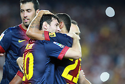 Lionel Messi celebrates with Adriano after scoring. Barcelona v Real Madrid, Supercopa first leg, Camp Nou, Barcelona, 23rd August 2012...Credit - Eoin Mundow/Cleva Media