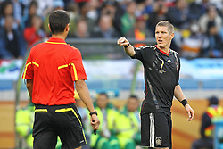 03.07.2010, CAPE TOWN, SOUTH AFRICA, im Bild .Bastian Schweinsteiger of Germany points to the Referee Ravshan Irmatov (UZB)  during the Quarter Final, Match 59 of the 2010 FIFA World Cup, Argentina vs Germany held at the Cape Town Stadium.Foto ©  nph /  Kokenge