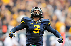 Oct 28, 2017; Morgantown, WV, USA; West Virginia Mountaineers linebacker Al-Rasheed Benton (3) celebrates after a turnover by Oklahoma State Cowboys during the first quarter at Milan Puskar Stadium. Mandatory Credit: Ben Queen-USA TODAY Sports