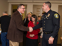 Lieutenant Kris Kelley greets Kent Hemingway during Thursday evenings Open House at the Gilford Police Department.  (Karen Bobotas/for the Laconia Daily Sun)
