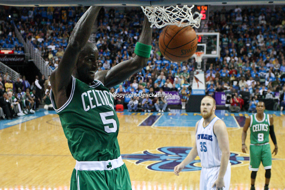 December 28, 2011; New Orleans, LA, USA; Boston Celtics power forward Kevin Garnett (5) dunks against the New Orleans Hornets during the third quarter of a game at the New Orleans Arena. The Hornets defeated the Celtics 97-78.  Mandatory Credit: Derick E. Hingle-US PRESSWIRE