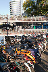 Bike garage and sidewalk parking outside Amsterdam's Central Train Station.