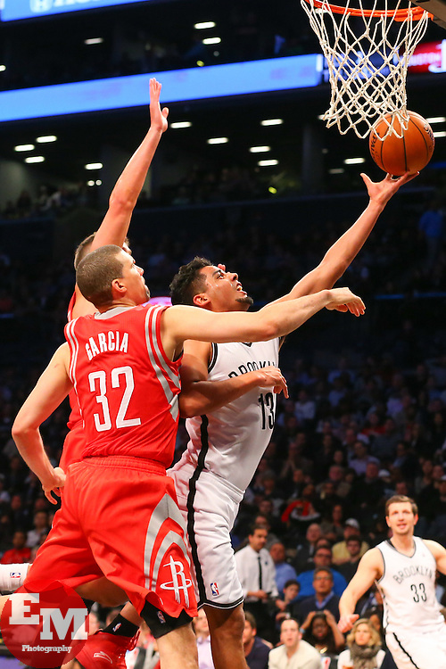 Apr 1, 2014; Brooklyn, NY, USA; Brooklyn Nets guard Jorge Gutierrez (13) shoots the ball while being defended by Houston Rockets guard Francisco Garcia (32) during the fourth quarter at Barclays Center. The Nets defeated the Rockets 105-96.