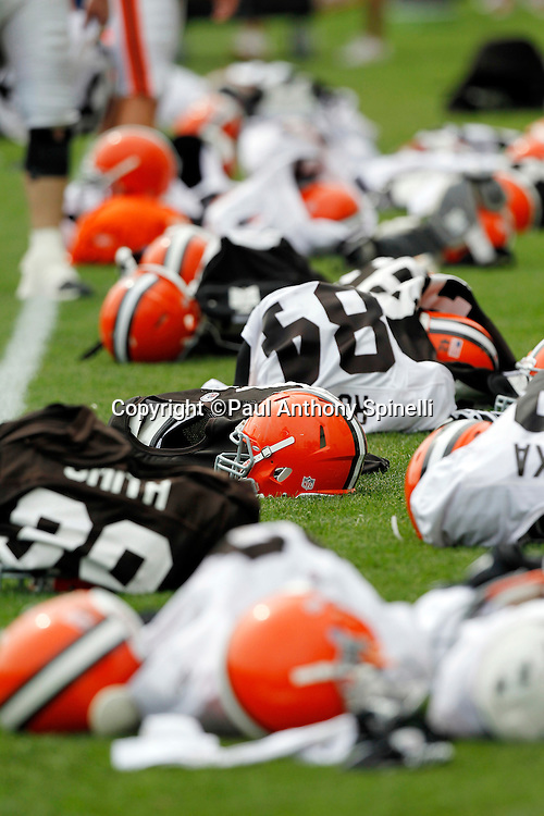 Cleveland Browns shoulder pads, helmets, and jerseys sit on the field as players run sprints during NFL football training camp at the Cleveland Browns Training Complex on Monday, August 9, 2010 in Berea, Ohio. (©Paul Anthony Spinelli)