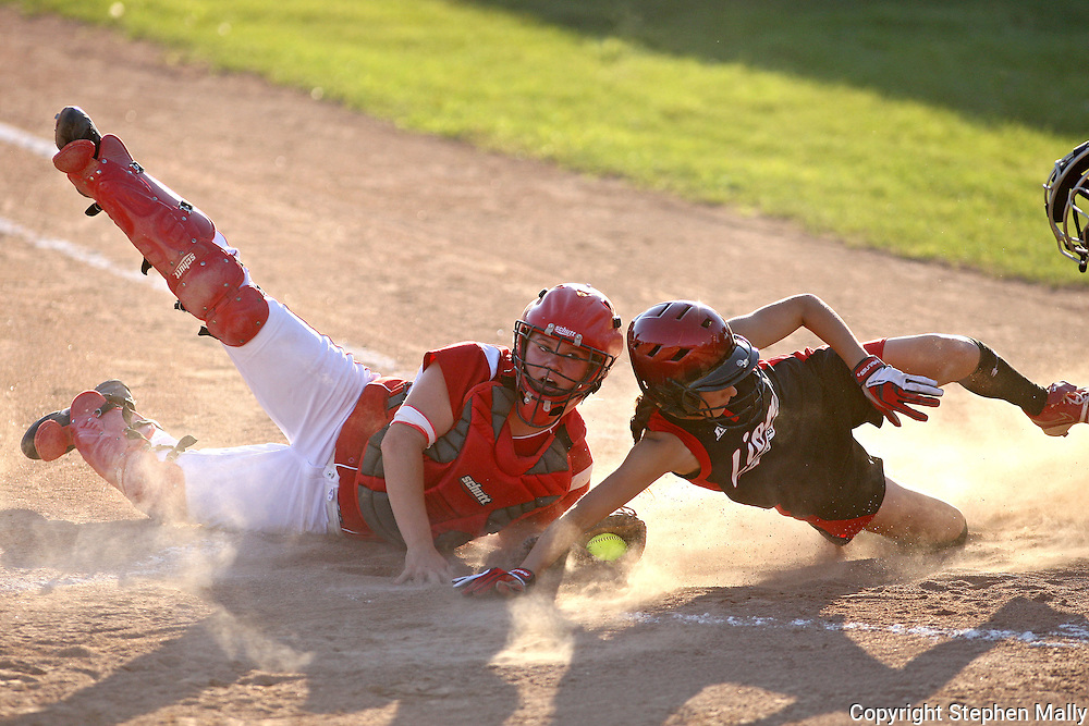 Washington catcher X tags out Linn-Mar's Kortlan Olinger, freshman, at the plate during the 4A Regional softball game between Washington and Linn-Mar at Jefferson High School at 1243 20th Street SW in Cedar Rapids on Saturday, July 10, 2010. (Stephen Mally/Freelance)