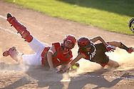 Washington catcher X tags out Linn-Mar's Kortlan Olinger, freshman, at the plate during the 4A Regional softball game between Washington and Linn-Mar at Jefferson High School at 1243 20th Street SW in Cedar Rapids on Saturday, July 10, 2010. (Stephen Mally/Freelance)