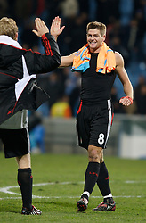 MARSEILLE, FRANCE - Tuesday, December 11, 2007: Liverpool's captain Steven Gerrard MBE embraces team-mate Dirk Kuyt after his side's 4-0 victory over Olympique de Marseille during the final UEFA Champions League Group A match at the Stade Velodrome. The win secures the Reds' place in the knock-out phase of the competition. (Photo by David Rawcliffe/Propaganda)