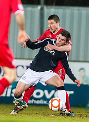 Raith Rovers's manager Grant Murray tackles Falkirk's Lewis Small..Falkirk 1 v 1 Raith Rovers, 5/3/2013.