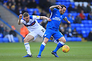 Ethan Hamilton challenges Lee Tomlin during the EFL Sky Bet League 1 match between Peterborough United and Rochdale at London Road, Peterborough, England on 12 January 2019.