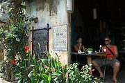 Vietnam: Hoi An. .Originally colonised by Chinese merchants, this traditional Vietnamese fishing community largely escaped damage during both the American and French Wars.Now protected by UNESCO, much of the original architecture remains in tact, providing a timeless reminder of the traditions of Vietnam...Cafe scene with western tourists