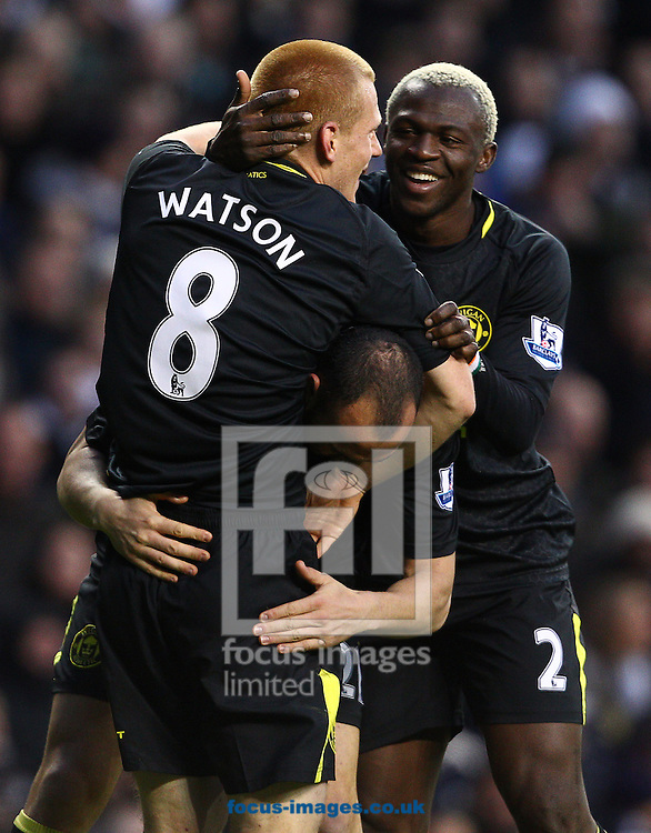 Picture by Paul Terry/Focus Images Ltd +44 7545 642257.03/11/2012.Ben Watson ( L )  of Wigan Athletic celebrates with Ivan Ramis ( C ) and Arouna Kone after scoring to make it 1-0 during the Barclays Premier League match at White Hart Lane, London.