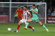 Chris Clemments and Ryan Loft   during the EFL Sky Bet League 2 match between Cheltenham Town and Carlisle United at Jonny Rocks Stadium, Cheltenham, England on 20 August 2019.