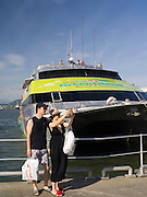 A Chinese couple prepares to take a tourist boat to the Great Barrier Reef, Cairns, Queensland, Australia.