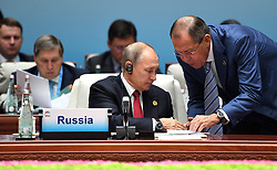 September 5, 2017 - Xiamen, China - September 5, 2017. - China, Xiamen. - From left in the foreground: Russian President Vladimir Putin and Foreign Minister Sergey Lavrov attend a meeting of BRICS leaders with delegation heads from invited states. (Credit Image: © Russian Look via ZUMA Wire)