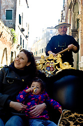 General Views of Venice, February 2012. Photo By Andrew Parsons/i-ImagesA mother and daughter taking a Gondola ride through the canals in the centre of Venice, February 2012. Photo By Andrew Parsons/i-Images