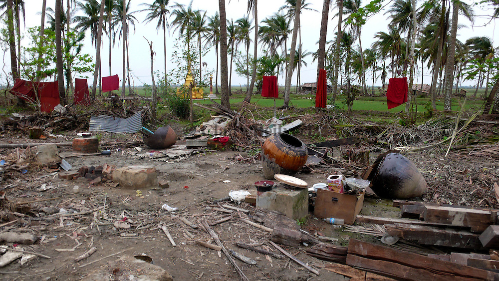 Near a temple in Pyapon, Bouddhist monk dress. Around two hundred villagers who were taking refuge in the temple died when it collapsed. All villages surrounding the temple were destroyed in the cyclone; but they still haven't received any aid from their government, and international NGOs have been unable to reach them.