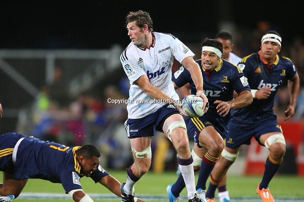 Blues Tom Donnelly looks to pass the ball against the Highlanders in the Super Rugby match, Forsyth Barr Stadium, Dunedin, New Zealand, Saturday, February 22, 2014. Photo: Dianne Manson / photosport.co.nz