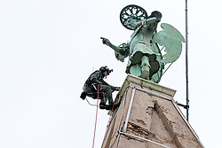 After two months of restoration, the Statue of Archangel Michael, made of copper plate, returned to Piran. The image shows Ales Hocevar of 151st Rotary Wing Squadron climbing down after helicopter placing the statue on top of the church's clock, on October 15, 2018 in Piran, Slovenia. Photo by Matic Klansek Velej / Sportida