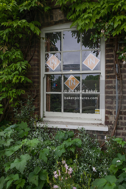 On polling day of the UK's EU (European Union) Referendum Day, is an IN (or Vote Remain in Europe), displayed in the window of a cottage in Dulwich Village, on 23rd June 2016, in south London, United Kingdom. (Photo by Richard Baker / In Pictures via Getty Images)