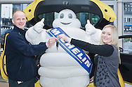 Dundee, 14th January, 2015. <br /> <br /> Michelin is committed to promoting road safety and has created the Michelin Young Driver Programme, which is aimed at employees&rsquo; children and young employees aged between 16 and 24, as part of its ongoing efforts to educate motorists about the dangers of the road. The project is designed to inform young drivers about road safety and offers a range of educational driving and road safety benefits including Drive iQ PRO, an online road safety programme, as well as the opportunity to have a car for a year.<br /> <br /> Rachel Cameron has been crowned the winner of the car which is a new Vauxhall Adam and she is seen pictured here with her father who works at the Dundee Michelin factory receiving the keys to her car along with the iconic Michelin Man.