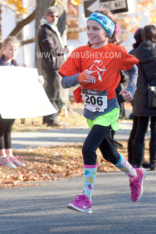 Cornwall-on-Hudson, New York - Girls in the Girls on the Run Hudson Valley program raced 3.1 miles at the Cornwall Lions Club Fall Harvest Race 5K on Nov. 10, 2013.