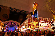 Tourists listen to music as they visit the Fremont Street Experience in Las Vegas, NV, April 20, 2006. Fremont Street dates back to 1905, when Las Vegas itself was founded. In 1931 the Northern Club received one of the first 6 gambling licenses issued in Nevada and the first one for Fremont Street.