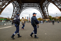 © Licensed to London News Pictures. 17/11/2015. Paris, France. French armed police patrolling the Eiffel Tower in Paris, France following the Paris terror attacks on Tuesday, 17 November 2015. Photo credit: Tolga Akmen/LNP