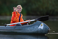 Suleika Suntken on a beaver safari per canoe near Rieth, Germany,  Oder river delta/Odra river rewilding area, Stettiner Haff, on the border between Germany and Poland