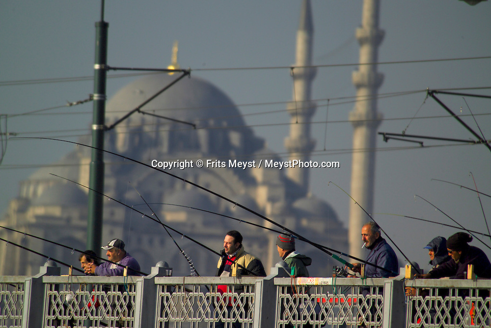 Istanbul, Turkey, October 2005. fishermen try their luck on the Galata bridge. Autumn falls over the dynamic city of Istanbul, former capital of the Ottoman empire. Photo by Frits Meyst/Adventure4ever.com