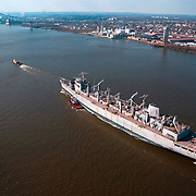 Aerial photographs of the USS Seattle being pulled down the Delaware River by Crowley Tug to be decommissioned Washington State after life at the Philadelphia Naval Shipyard