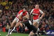 Mike Phillips of Wales runs into Daniel Braid of the Allblacks (19) .Invesco Perpetual match, Wales v New Zealand at the Millennium stadium in Cardiff on Sat 27th Nov 2010.  pic by Andrew Orchard, Andrew Orchard sports photography,