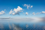 Fog clearing from surface of lake to reveal blue water under blue sky, Yellowstone Lake, WY, © 2005 David A. Ponton