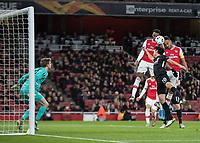 Football - 2019 / 2020 UEFA Europa League - Group F:Arsenal vs. Eintracht Frankfurt<br /> <br /> Pierre-Emerick Aubameyang (Arsenal FC) rises with Joe Willock (Arsenal FC) to head towards goal  at The Emirates.<br /> <br /> COLORSPORT/DANIEL BEARHAM