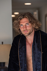 hot man in an open smoking jacket at home