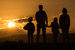© Licensed to London News Pictures. 28/08/2015. Huddersfield, UK. Picture shows a family enjoying the good weather on Castle Hill in Huddersfield. Whilst the UK is expecting unsettled weather over the bank holiday weekend Yorkshire is experiencing clear skies & bright sunshine. Photo credit: Andrew McCaren/LNP